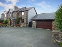 A charming character property situated within a hamlet location with many character features...